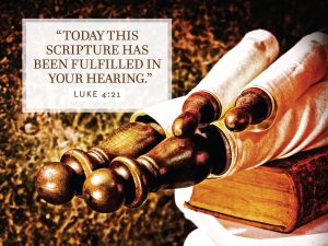 """Photo of scrolls rolled up on a Bible with the words, """"Today this scripture is fulfilled in your hearing."""""""
