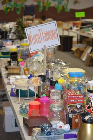 """Photo of a table full of items with a sign, """"Miscellaneous."""""""