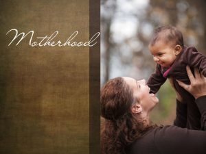 """The word, """"Motherhood"""" with a photo of a mother holding up a baby."""