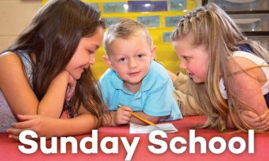"Photo of three children at a table with the words, ""Sunday School."""