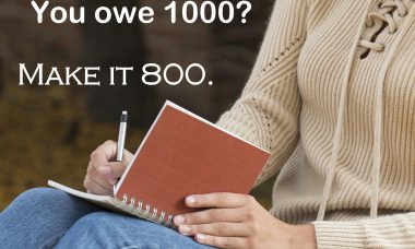 "The words, ""You owe 1000? Make it 800."" over a photo of a woman holding a pencil and a notebook."