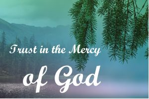 "The words, ""Trust in the Mercy of God,"" over a photo of fir bough by a mountain lake."