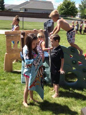 Photo of children climbing on playground toys.